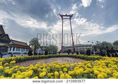 BANGKOK THAILAND - OCTOBER 26: Unidentified people gather for the cremation of Rama IX the former king at the giant swing surrounded by marigolds in Bangkok Thailand on October 26 2017.
