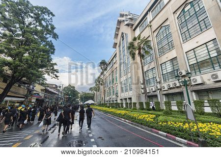 BANGKOK THAILAND - OCTOBER 26: Unidentified people walk past the BMA building for the cremation of Rama the IX in Bangkok Thailand on October 26 2017.
