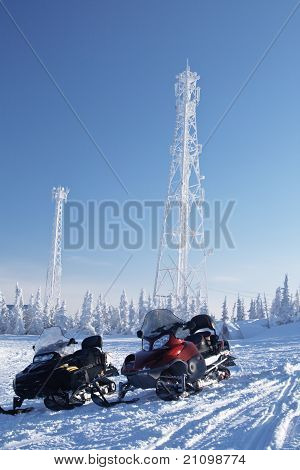 Snowmobiles And Communication Equipment In Forest