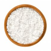 Powdered sugar in wooden bowl. Unsifted finely ground white refined sugar. Also called confectioners or icing sugar and icing cake. Isolated macro food photo close up from above on white background. poster