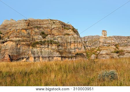 Rock Formations In Isalo National Park, Ilakaka, Madagascar. Stone Statute Known As Lady Queen Of Is