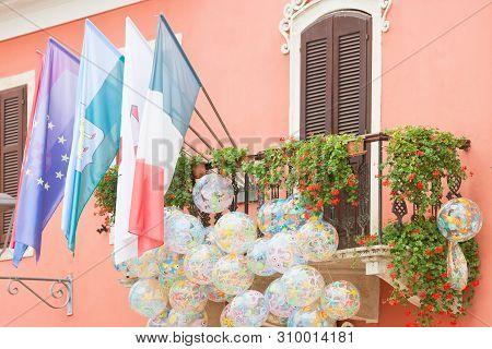 Novigrad, Istria, Croatia, Europe - Flags And Beachballs At A Picturesque Balcony