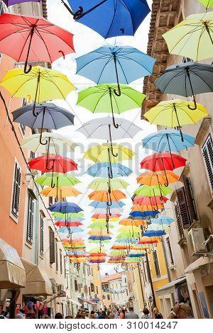Novigrad, Istria, Croatia, Europe - September 3, 2017 - Natives And Tourists Walking Through Under C