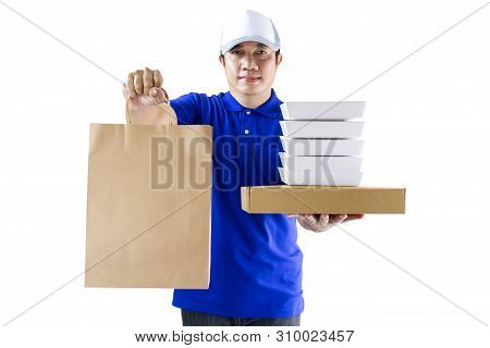 Food Delivery Service Or Order Food Online. Delivery Man In Blue Uniform Hand Holding Food Packaging