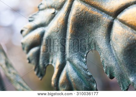 Metal Grapes Leaf. Forged Ornament. Painted In Bronze Color. Close-up.