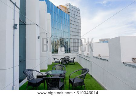 Outdoor Seating Space In A Building With Artificial Grass And Seats