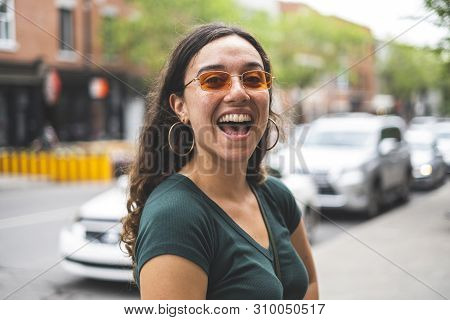 Happy Woman Outside In The City Streets