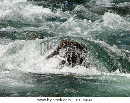 River rushing over rock