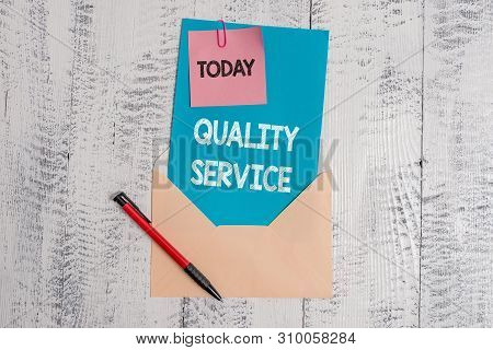Text sign showing Quality Service. Conceptual photo how well delivered service conforms to clientexpectations Envelope blank sheet letter paper sticky note ballpoint wooden background. poster