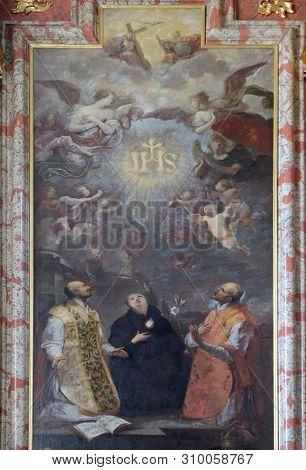 LUCERNE, SWITZERLAND - JUNE 24, 2018: St. Ignatius of Loyola, St. Stanislaus and St. Francis Borgia, Saint Ignatius altar in Jesuit church of St. Francis Xavier in Lucerne, Switzerland