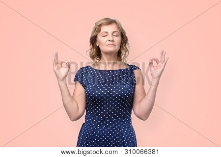 Mature Woman Feels Relaxed, Tries To Concentrate Or To Be Focused, Closes Eyes, Enjoys Silence.