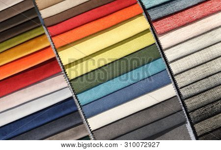 Multi-colored Samples Of Upholstery Fabric For Sofas And Chairs Close-up. Selection Of Fabric For In