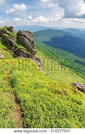 Path Through The Edge Of A Mountain. Beautiful Summer Landscape In Mountains. Big Rock On The Grassy