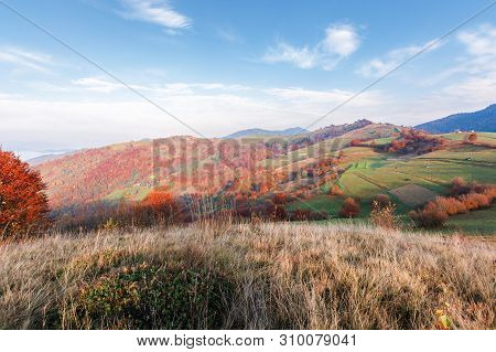 Calm Autumn Morning In The Mountains. Beautiful Rural Area With Fields And Orchards On Hills. Tradit