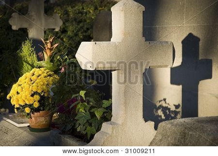 Grave with shadow cross at cemetery