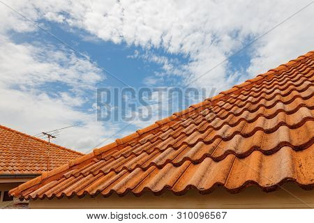 Close Up Of Brown Clay Roof Tiles. Red Old Dirty Roof. Old Roof Tiles. Construction Equipment Build