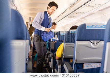 June 27, 2019 - Bangkok Airways Flight Attendant Serve Drink To Passengers.