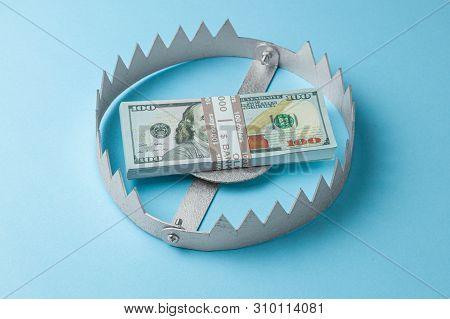 Trap With A Stack Of Money. Dangerous Risk For Investment Or Deception In Business. Blue Background