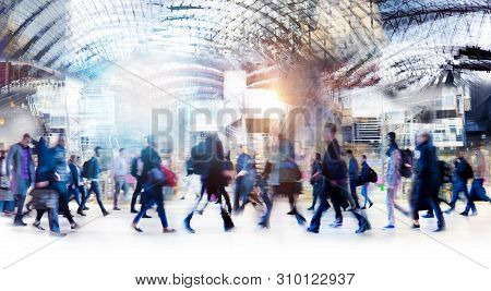 Beautiful Motion Blur Of Walking People In Train Station. Early Morning Rush Hours, Busy Modern Life