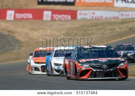 June 23, 2019 - Sonoma, California , USA: Erik Jones (20) battles for position for the TOYOTA/SAVE MART 350 at Sonoma Raceway in Sonoma, California .