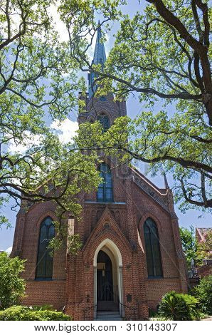 Landmark Church Front And Steeple Of Gothic Revival Architecture In New Orleans Louisiana