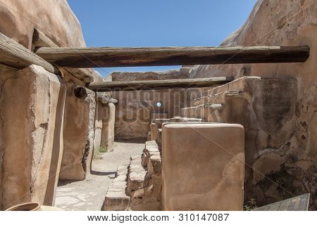 Historic Native Pueblo Interior. Empty interior of ancient adobe in the American Southwest desert at Tumacacori National Park in Arizona. poster