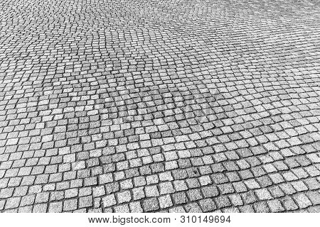 Old Pavement Of Granite Texture.