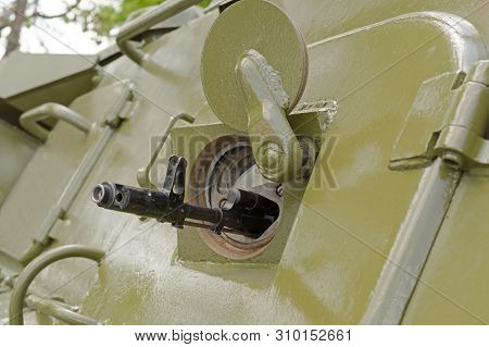 The Barrel Of The Machine In The Embrasure Of Armoured Troop-carrier Wheeled