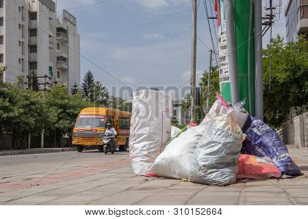 Bengaluru, India June 27, 2019 : Bags Of Rubbish Lie On The Footpath Of The Road. A Bunch Of Trash T