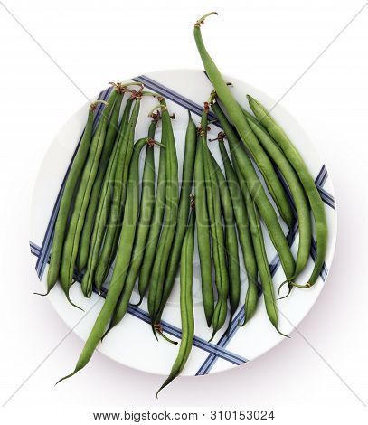 Still Life With Whole Raw Green Beans On A Beautiful Plate Against White Background.  Selective And