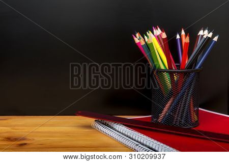 Back To School Concept With Stationery Supplies And Blackboard. Pencil Box, Pencils, Notebook, Ruler