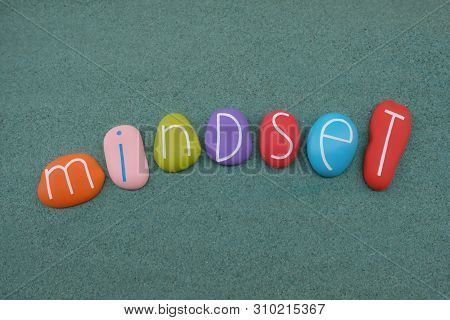 Mindset Text Composed With Multi Colored Stones Over Green Sand