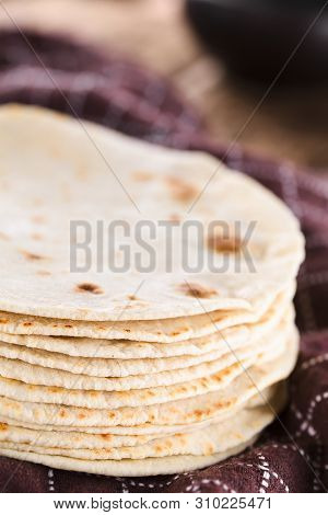Fresh Homemade Flour Tortillas On Kitchen Towel (selective Focus, Focus On The Front Of The Tortilla