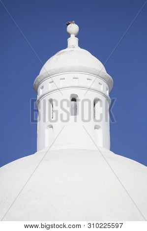 Whitewashed Dome From Jerez De Los Caballeros Alcazaba, Spain. Closeup Over Blue Sky