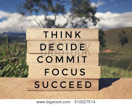 Motivational And Inspirational Wording - Think, Decide, Commit, Focus, Succeed Written On Wooden Blo