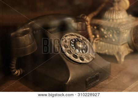 Collectibles And Decoration - Classic And Old Telephone Reciever. Retro Technology. Vintage Color To