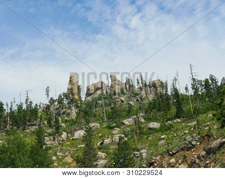 Upward Shot Of Dramatic Granite Rock Formations Sticking Out To The Skies, One Of The Best Attractio