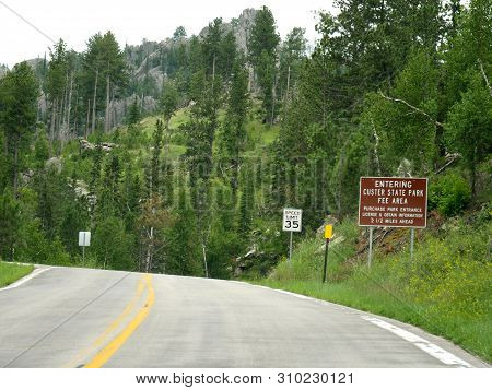 Roadside Directional And Speed Limit Signs Near Approaching Custer State Park In South Dakota.