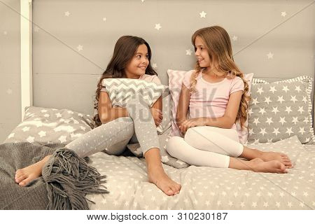 Girls Happy Best Friends Or Siblings In Cute Stylish Pajamas With Pillows Sleepover Party. Sisters H