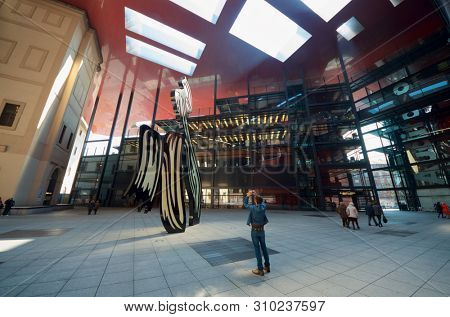 Madrid, Spain - March 22, 2012: tourists visit Nouvel Edifice in the museum Reina Sofia. This museum  is dedicated to the exhibition of modern and contemporary art.