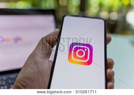 Chiang Mai, Thailand - May.26,2019: Man Holding Xiaomi Mi Mix 3 With Instagram Application On The Sc