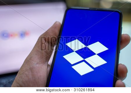 Chiang Mai, Thailand - May.26,2019: Man Holding Xiaomi Mi Mix 3 With Dropbox On Screen.dropbox Is A