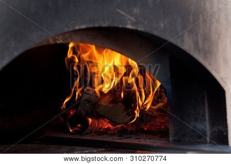 Burning Firewood In A Large Stove