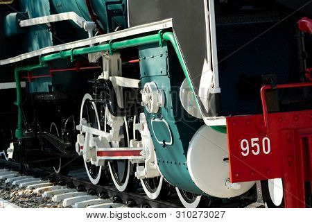 Closeup Wheel Of Train. Green Red And White Train. Antique Vintage Train Locomotive. Old Steam Engin