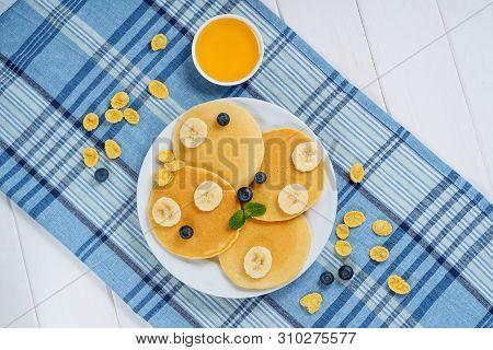 Pancake Plate Blueberry Honey Dessert Top View. Fried Golden Sweet Crepe For Tasty Shrovetide Breakf