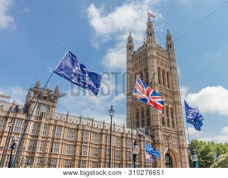 London / Uk - June 26th 2019 - European Union And Union Jack Flags Waving Outside Uk Parliament, Hel