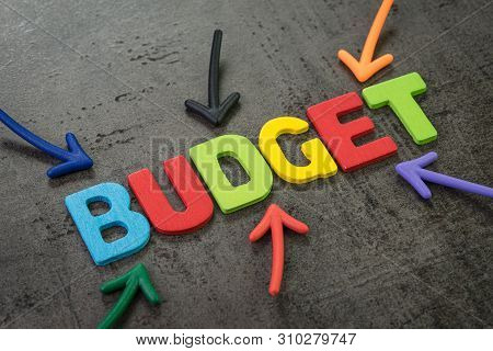 Budget, Financial Planning Or Balance Calcultation Concept, Multi Color Arrows Pointing To The Word
