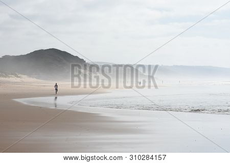 Beach Activity On An Overcast Summer Day, Mossel Bay, South Africa