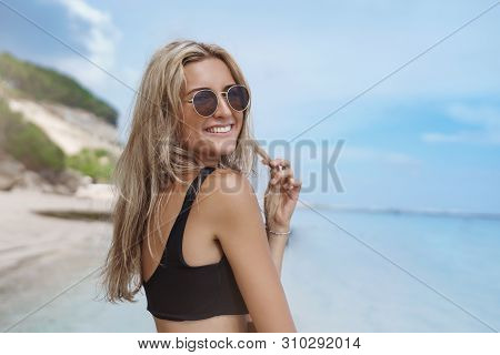 Happy Carefree Attractive Tanned Blond Woman Enjoy Summer Vacation Walking Sandy Beach Ocean Shore T