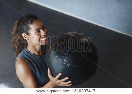High Angle View Motivated Satisfied Sweaty Hispanic Sportswoman, Fitness Instructor Lift Medicine Ba